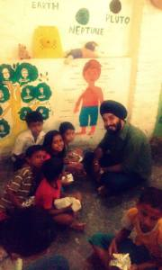 Volunteers spend time with the children at Lakshyam